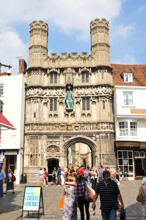 Canterbury, UK - 10 August, 2012 - Tourists walk along medieval cobbled streets in the old town of Canterbury
