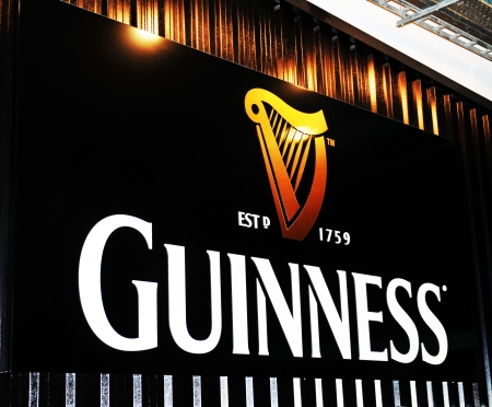 brew house: Dublin, Ireland - 30 March, 2013 - Guinness logo at the entrance to Guinness Storehouse  Hop Store , a major tourist attraction located at St  Jamess Gate Brewery