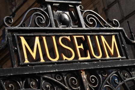 visitors: Museum sign on old metallic gate Stock Photo