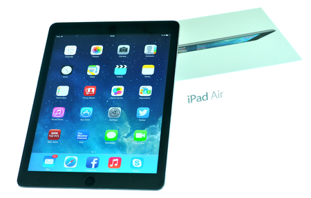 London, UK – December 13th, 3013 - iPad Air and box isolated on white  iPad Air is the fifth generation iPad tablet computer designed, developed and marketed by Apple Inc   released on November 1, 2013 Editorial