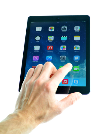 London, UK � December 13th, 3013 - User presenting the new iPad Air, the fifth generation iPad tablet computer designed, developed and marketed by Apple Inc   released on November 1, 2013 新闻类图片