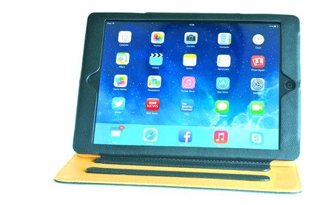 marketed: London, UK – December 13th, 3013 - Leather case for iPad air, the fifth generation iPad tablet computer designed, developed and marketed by Apple Inc   released on November 1, 2013 Editorial