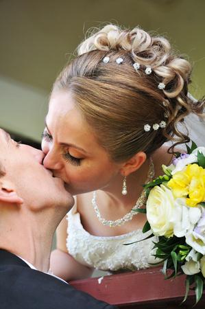 bridal couple: Kiss the bride