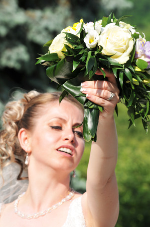throws: Bride throws the bouquet Stock Photo