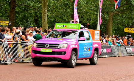 London, UK - July 7, 2014  Sponsors caravan arrive at The Mall in London which hosted the third stage of the Tour de France