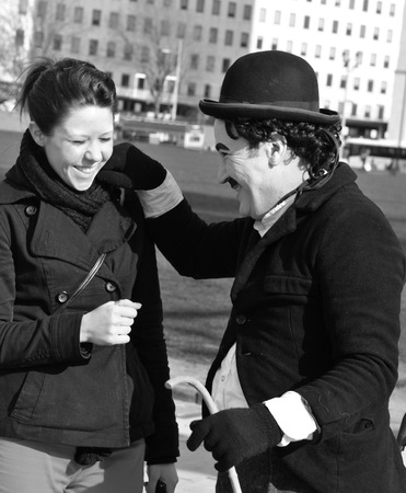 LONDON, UK - MARCH 5, 2011: Charlie Chaplin entertains tourists on the streets of London