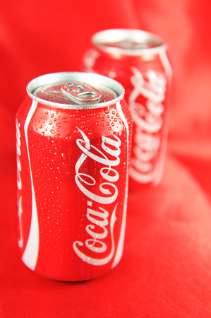 LONDON, UK - FEBRUARY 27, 2011: Detail of fresh Coca Cola can on red background (illustrative editorial)