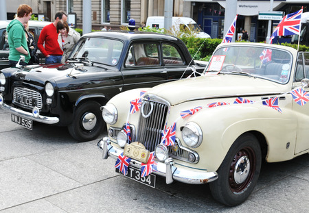 NOTTINGHAM, UK - APRIL 29, 2011: Vintage cars on display in the Old Market Place during the Vintage Cars Festival celebrating the Royal Wedding of Prince William and Kate Middleton Editorial
