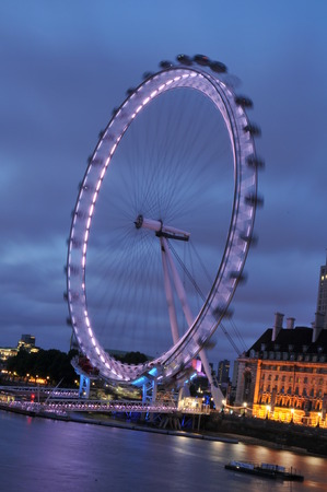 eye traveller: LONDON, UK - AUGUST 21, 2010: Panorama of London skyline with the famous London Eye at night