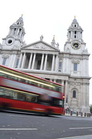LONDON, UK - AUGUST 23, 2010: Red bus in traffic by Saint Paul cathedral in central London