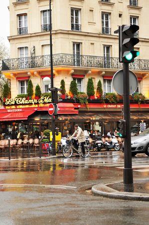 elysees: PARIS, FRANCE - MARCH 30, 2011:  French brasserie in the famous district of Champs Elysees in Paris