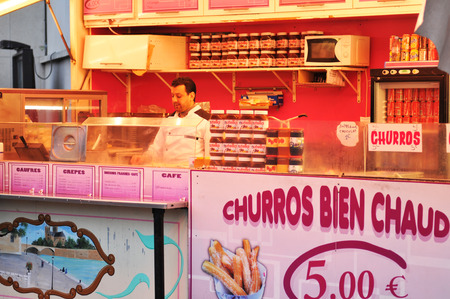 PARIS, FRANCE - MARCH 30, 2011: Traditional churros and crepes for sale in Paris Editorial