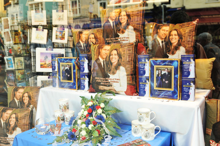 by catherine: WINDSOR, UK - APRIL 24, 2011: Windsor shop displays souvenirs of the Royal wedding of Prince William and Catherine Middleton
