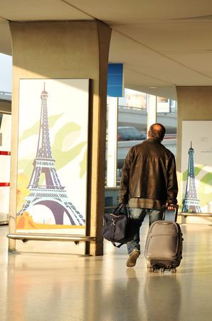 PARIS, FRANCE - MARCH 27, 2011: Tourist transits Charles de Gaulle airport in Paris