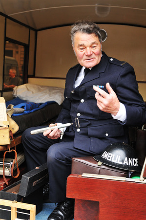 narrator: NOTTINGHAM, UK - MAY 7, 2011: World War II veteran talking to the visitors at Nottingham Fire Station Open Day
