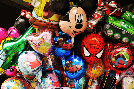 spiderman: PARIS, FRANCE - JUNE 25, 2011: Colorful balloons depicting famous cartoons characters at Disneyland