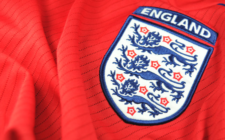 illustrative: LONDON, UK - MARCH 8, 2011: Detail of England national footballrugby team logo on T-shirt (illustrative editorial)