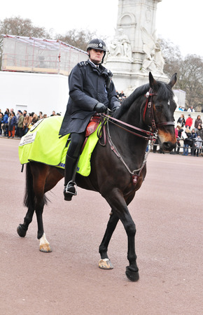 patrolling: LONDON, UK - MARCH 8, 2011:  Mounted police officer patrolling in Buckingham Palace area Editorial