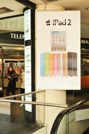advertised: PARIS, FRANCE - MARCH 30, 2011: iPad 2 for sale in a shopping mall on Champs-Elysees, Paris.