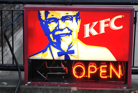 LONDON, UK - MARCH 8, 2011: Close up of KFC fast food restaurant neon logo on London streets