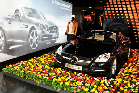 advertised: PARIS, FRANCE - MARCH 28, 2011: Mercedes Classe SLK presented in a shopping centre on Champs-Elysees in Paris Editorial