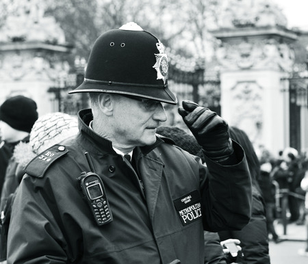 LONDON, UK - MARCH 5, 2011: London local Metropolitan policeman in uniform raises his hat