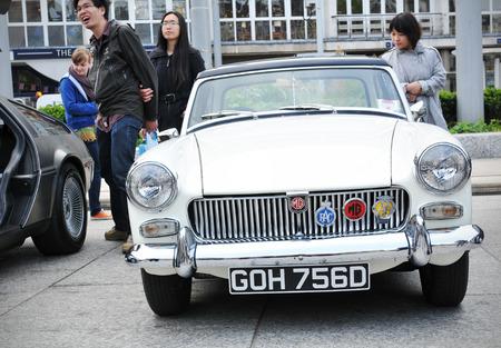 middleton: NOTTINGHAM, UK - APRIL 29, 2011: Vintage car on display in Nottingham Old Market Place during the Vintage Cars Festival celebrating the Royal Wedding of Prince William and Kate Middleton