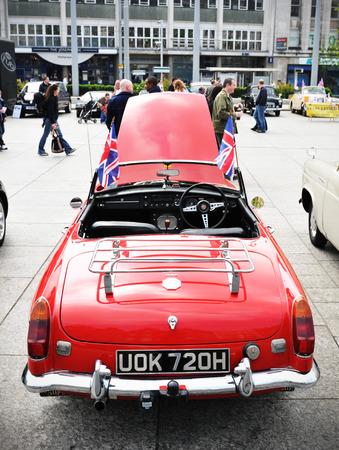 NOTTINGHAM, UK - APRIL 29, 2011: Vintage car on display in Nottingham Old Market Place during the Vintage Cars Festival celebrating the Royal Wedding of Prince William and Kate Middleton
