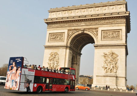 PARIS, FRANCE - MARCH 29, 2011: Tourists sightseeing the famous Arc de Triomphe in Paris