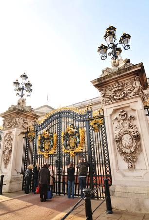 buckingham palace: LONDON, UK - NOVEMBER 18, 2011: Tourists visit the Buckingham Palace, major tourist landmark in central London