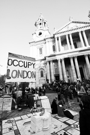 London, UK - 19 Nov, 2011: Occupy London activists protest against economic inequality in front of Saint Paul cathedral in London.