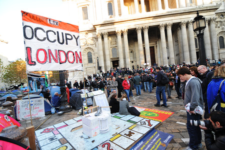 occupy london: London, UK - 19 Nov, 2011: Occupy London activists protest against economic inequality in front of Saint Paul cathedral in London.