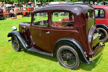 vintage car: NOTTINGHAM, UK. JUNE 1, 2014: Austin retro car displayed at the vintage car fair in Nottingham, England. Editorial