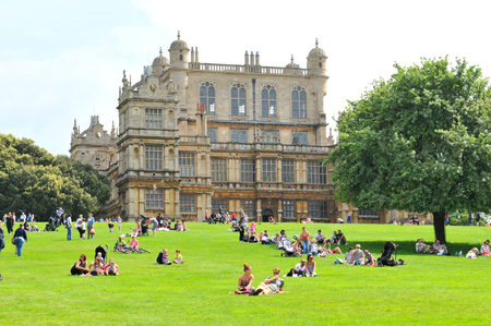 elizabethan: NOTTINGHAM, UK. JUNE 1, 2014: Tourists admire the beautiful architecture of Wollaton Hall, an Elizabethan country house.