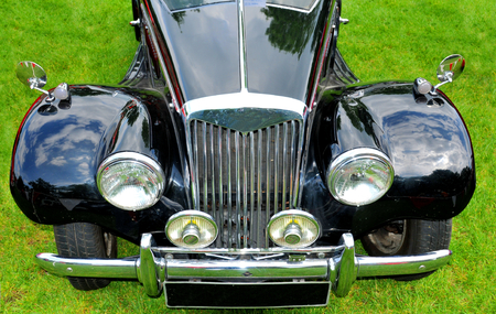 frontal view: NOTTINGHAM, UK. JUNE 1, 2014: Front view of vintage MG car for sale in Nottingham, England. Editorial
