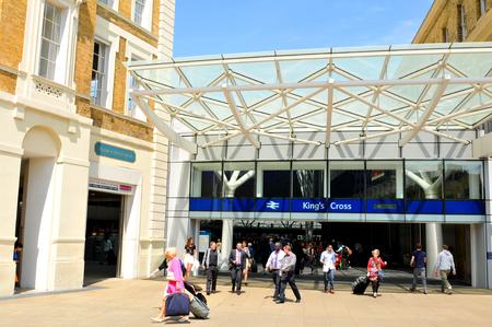 rail cross: LONDON, UK - JULY 9, 2014: People transit the Kings Cross train station in London.