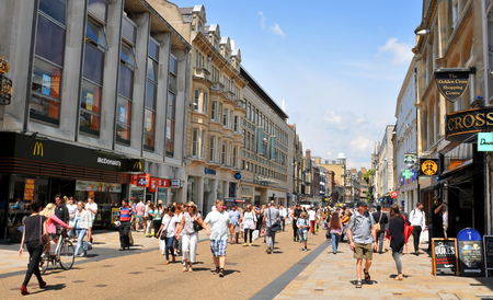 oxford street: OXFORD, UK - JULY 9, 2014: Tourists in the city centre of Oxford, Oxfordshire - England Editorial