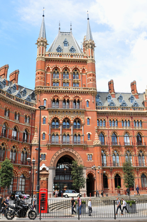 pancras: LONDON, UK. JULY 9, 2014: Tourists admire the architecture of the St. Pancras Renaissance hotel in London