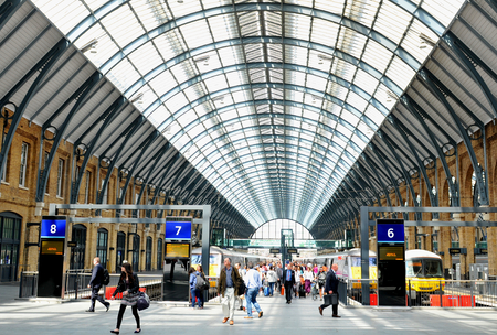 train ticket: LONDON, UK - JULY 9, 2014: People transit the Kings Cross underground station in London. Editorial
