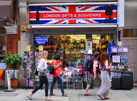 souvenir: LONDON, UK. JULY 9, 2014: Tourists pass by the entrance to souvenir shop in central London Editorial