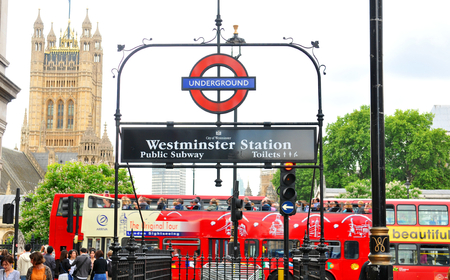 LONDON, UK - JULY 9, 2014: Westminster underground station outside the government offices of the Houses of Parliament