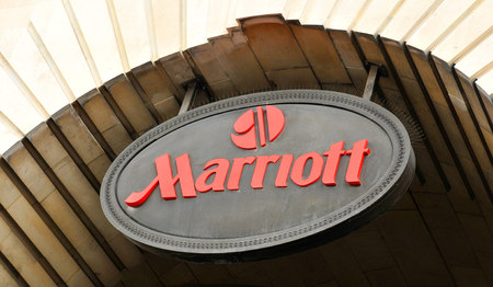 LONDON, UK - JULY 9, 2014: Close up of the logo of the hotel chain Marriott in London. Publikacyjne