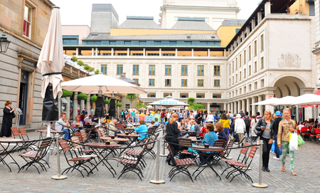 covent: LONDON, UK. JULY 9, 2014: Tourists visit the Covent Garden, important cultural landmark in central London Editorial