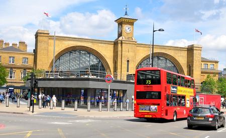 rail cross: LONDON, UK. JULY 9, 2014: People travel via Kings Cross train station in London.