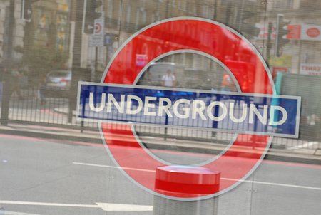 illustrative editorial: LONDON, UK - JULY 9, 2014: Abstract close up of London Underground sign illustrative editorial