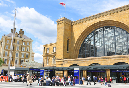 king street: LONDON, UK - JULY 9, 2014: People transit the Kings Cross underground station in London. Editorial