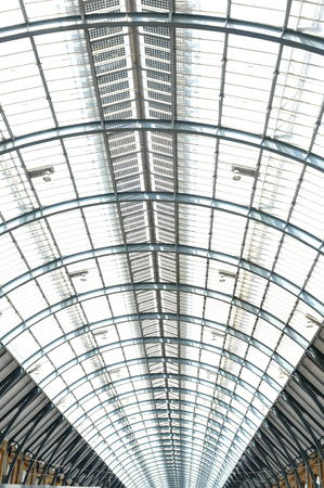 pancras: LONDON, UK - JULY 9, 2014: Modern roof structure detail inside St Pancras train station in London Editorial