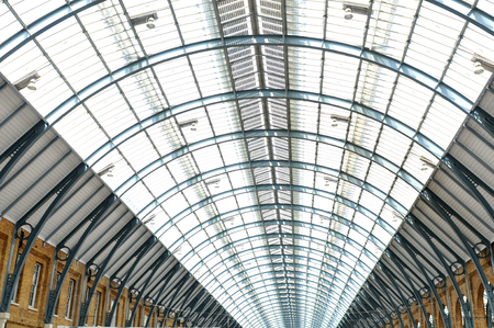 glasswork: LONDON, UK - JULY 9, 2014: Modern roof structure detail inside St Pancras train station in London Editorial