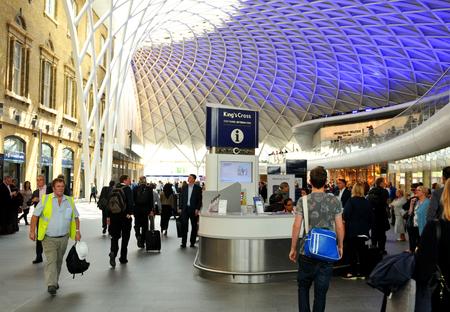 rail cross: LONDON, UK - JULY 9, 2014: People transit the Kings Cross underground station in London. Editorial