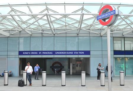 king street: LONDON, UK. JULY 9, 2014: People enter the Kings Cross train station in London.